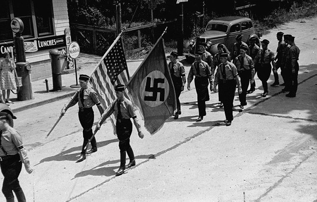 nazis-marching-with-their-swastika-flag-and-u-s-flag